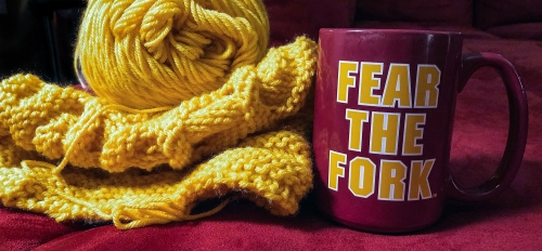 "gold yarn and mug that says ""Fear the Fork"""