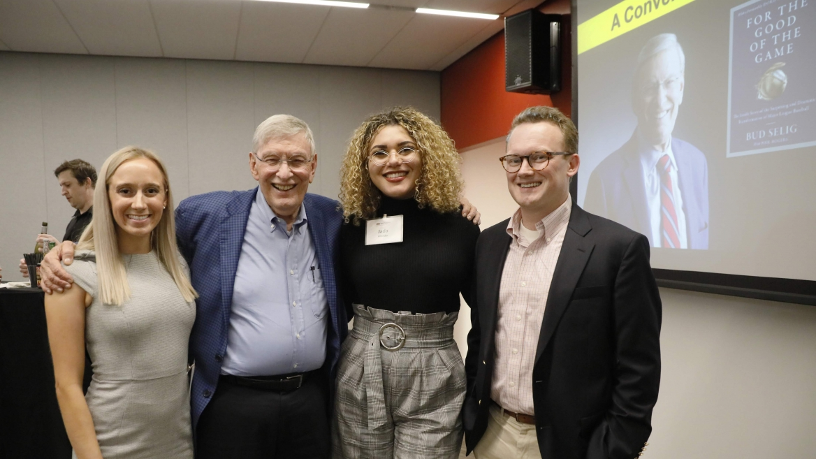 photo of Selig Scholars and Commisioner Selig with Professor Zachary Gubler