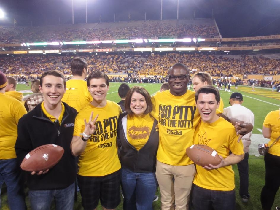 Frank Smith poses with friends at an ASU football game