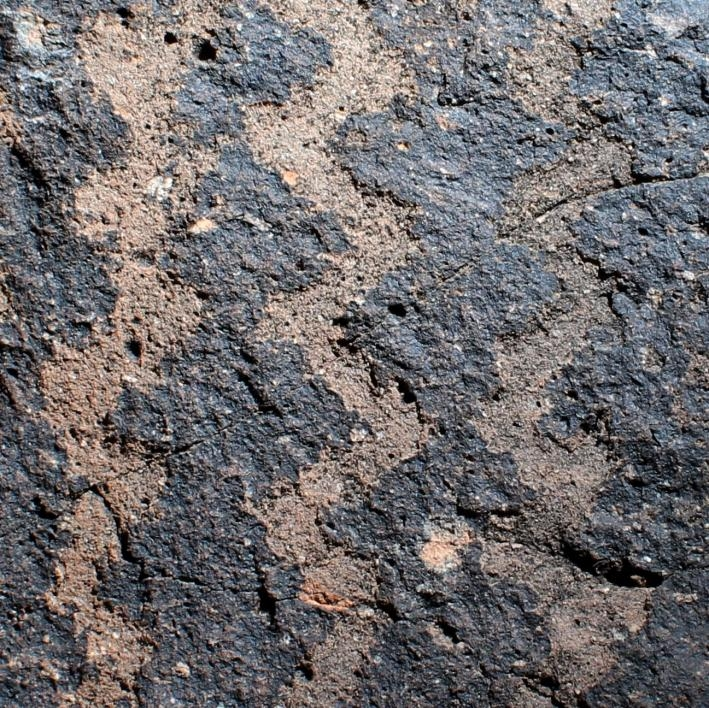 photo of petroglyph of zigzag lines