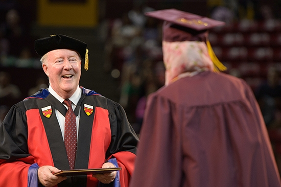 dean greeting student at convocation