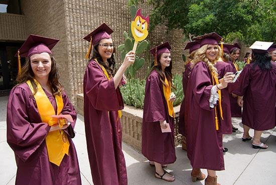 graduates standing outside convcation