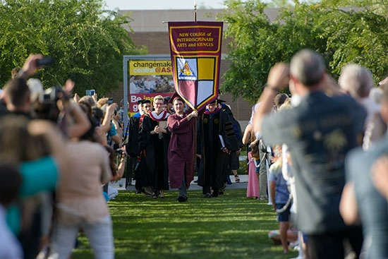 students carrying gonfalons into convocation