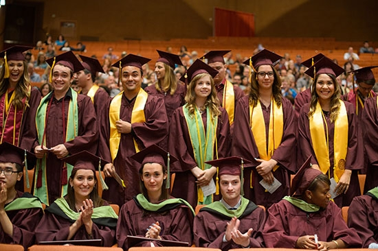 students standing at convocation