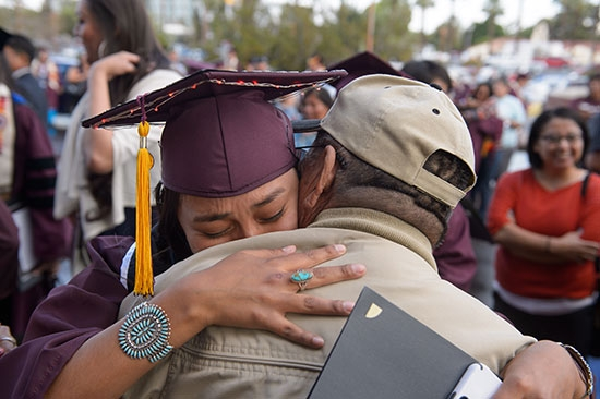 two people hugging after convocation