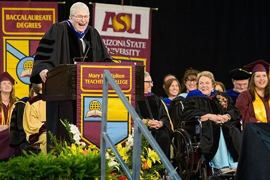 man speaking at podium at convocation