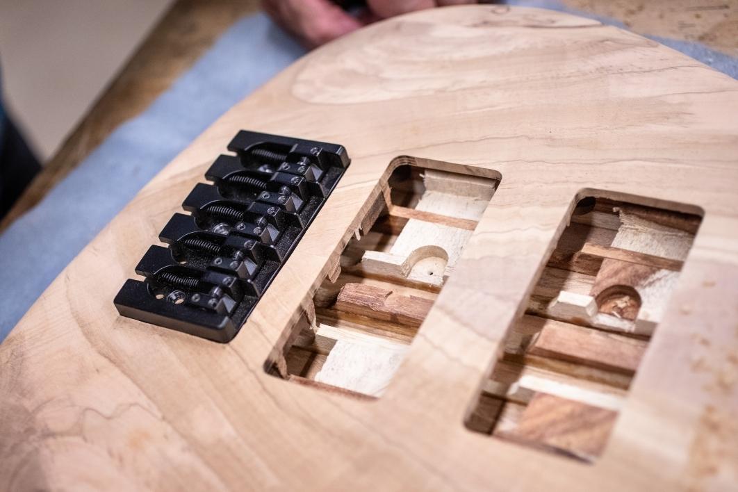 Bridge is inset in guitar body