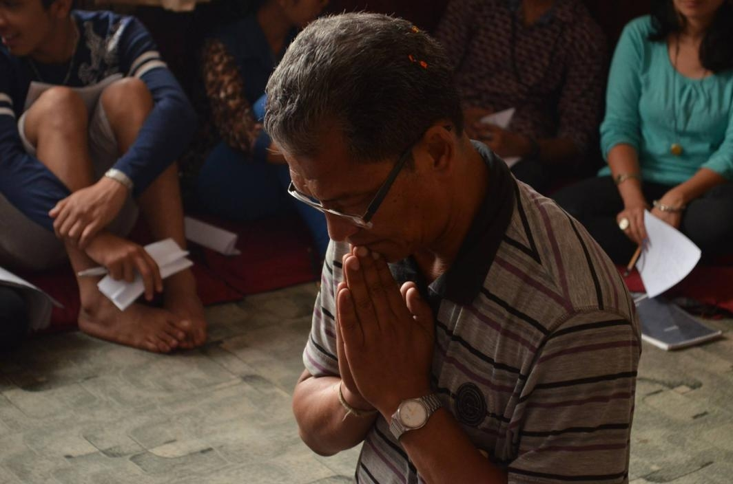 Man Prays at Workshop
