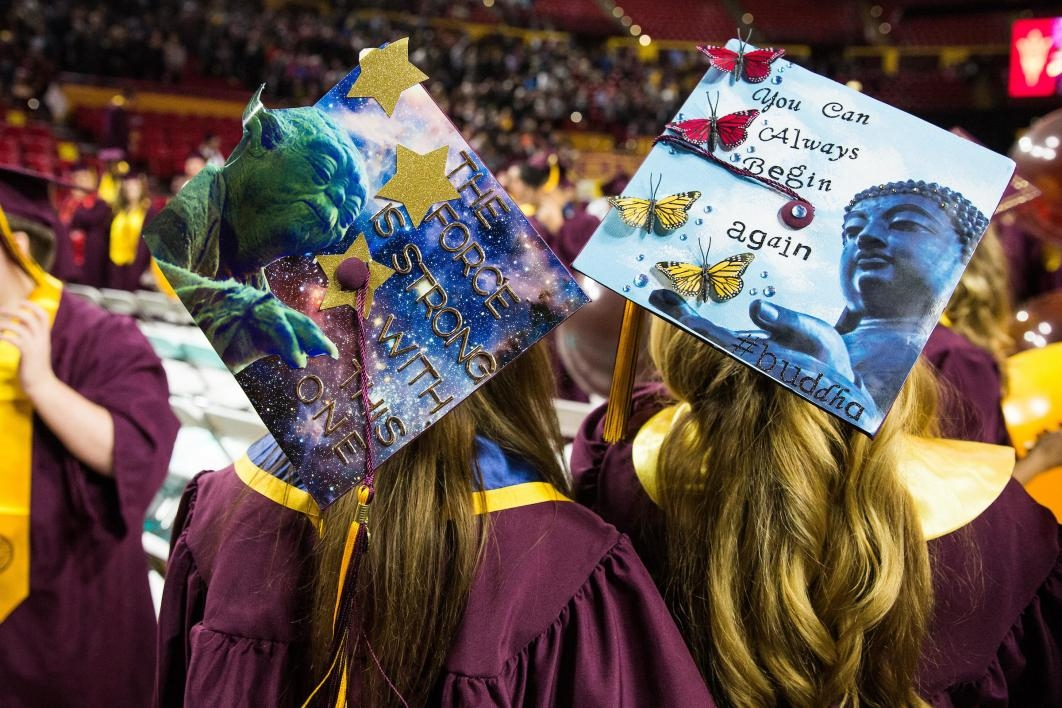 decorated mortarboards at graduation