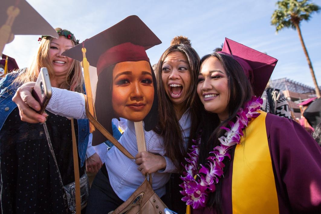 student and aunt taking selfie at graduation