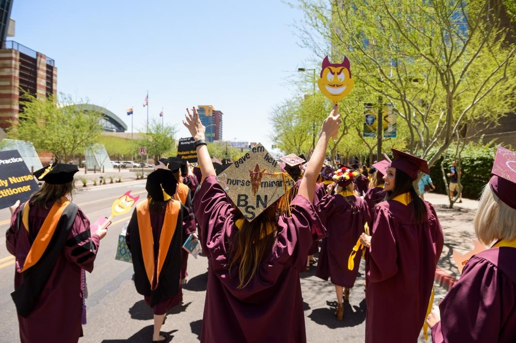 graduates walking down downtown Phoenix street