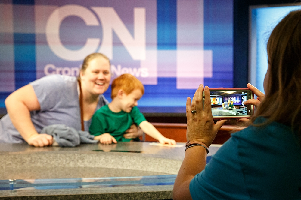 Mother and son in Cronkite Newsroom