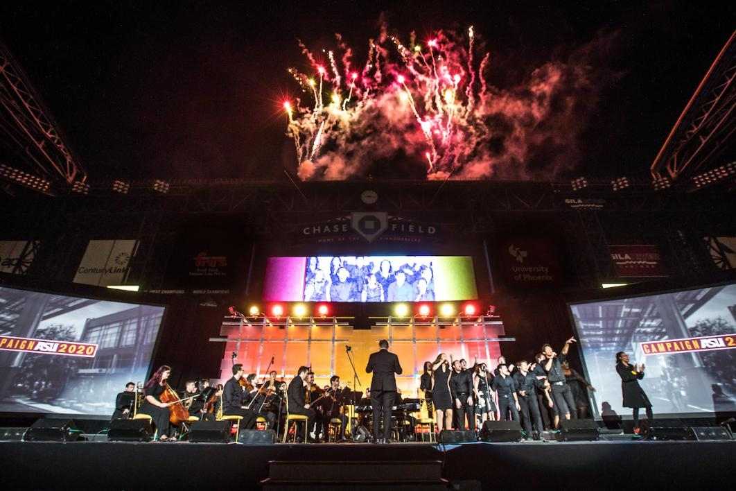 launch of event on stage with fireworks above stage