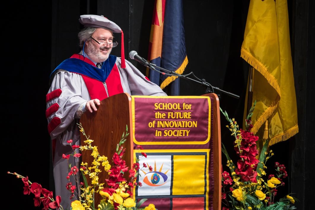 man speaking at podium at convocation