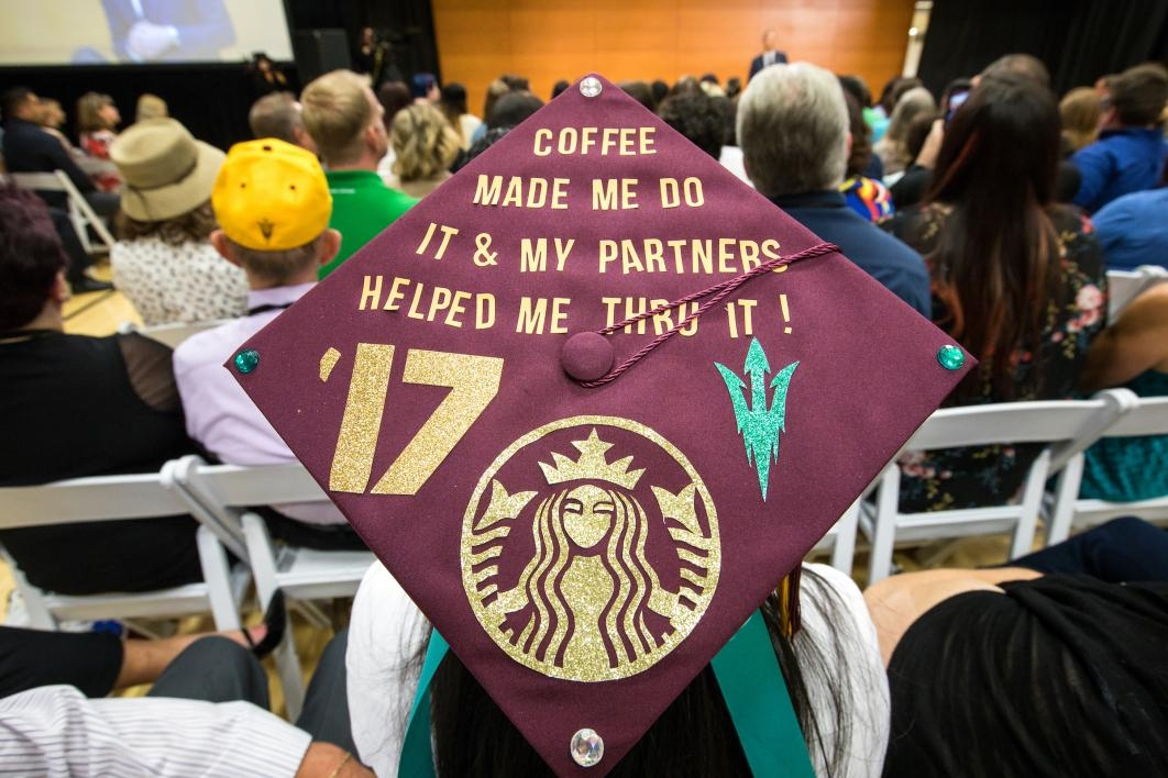 "decorated mortarboard that says ""Coffee made me do it and my partners helped me through it!"""