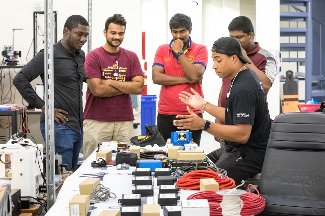 The AZLoop team looks over electrical components