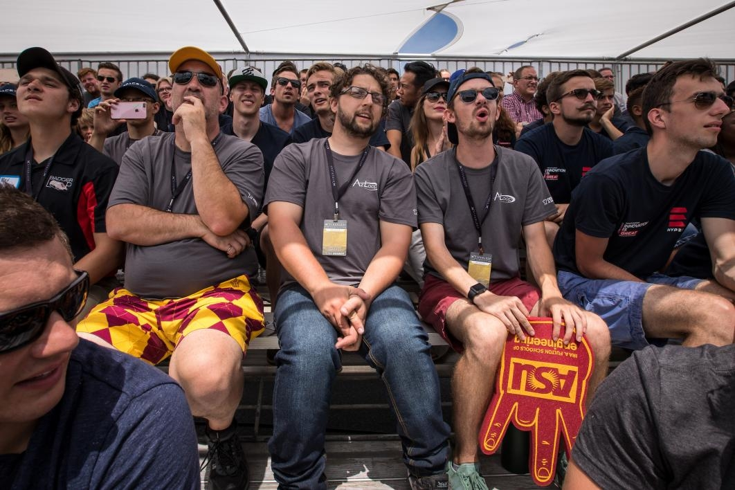 AZLoop team sitting in the stands