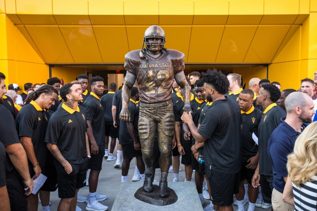 Football players check out the new Pat Tillman statue