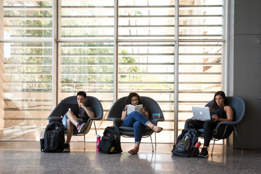 students studying in oversize chairs