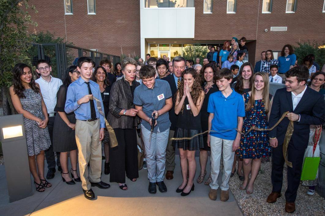 Students cut the ribbon at the opening of the Herberger Young Scholars Academy building