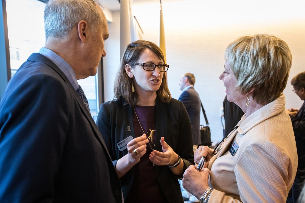 A locust researcher talks to people at a reception