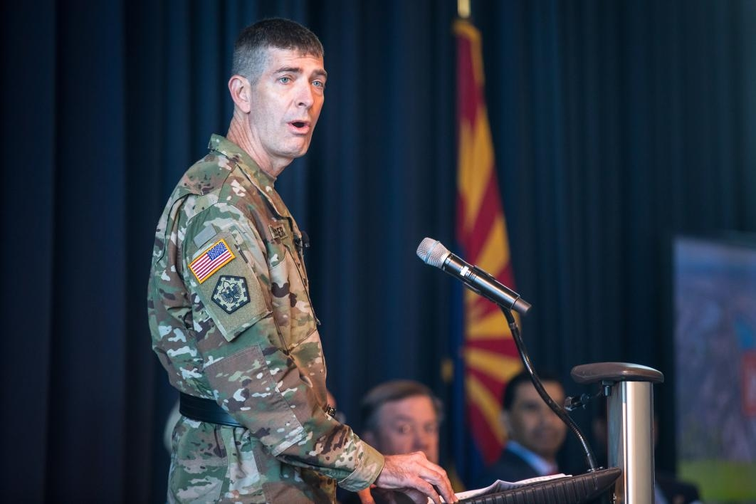 An Army engineer speaks at a lectern