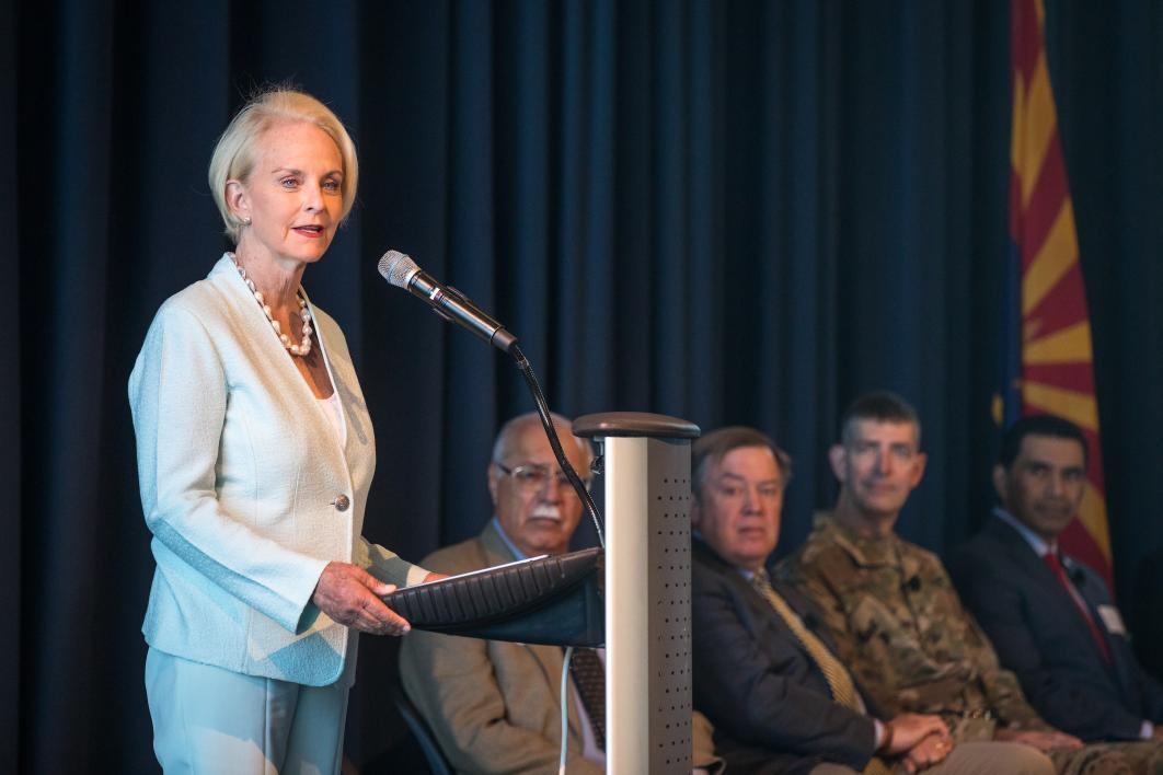 Cindy McCain speaks at a lectern