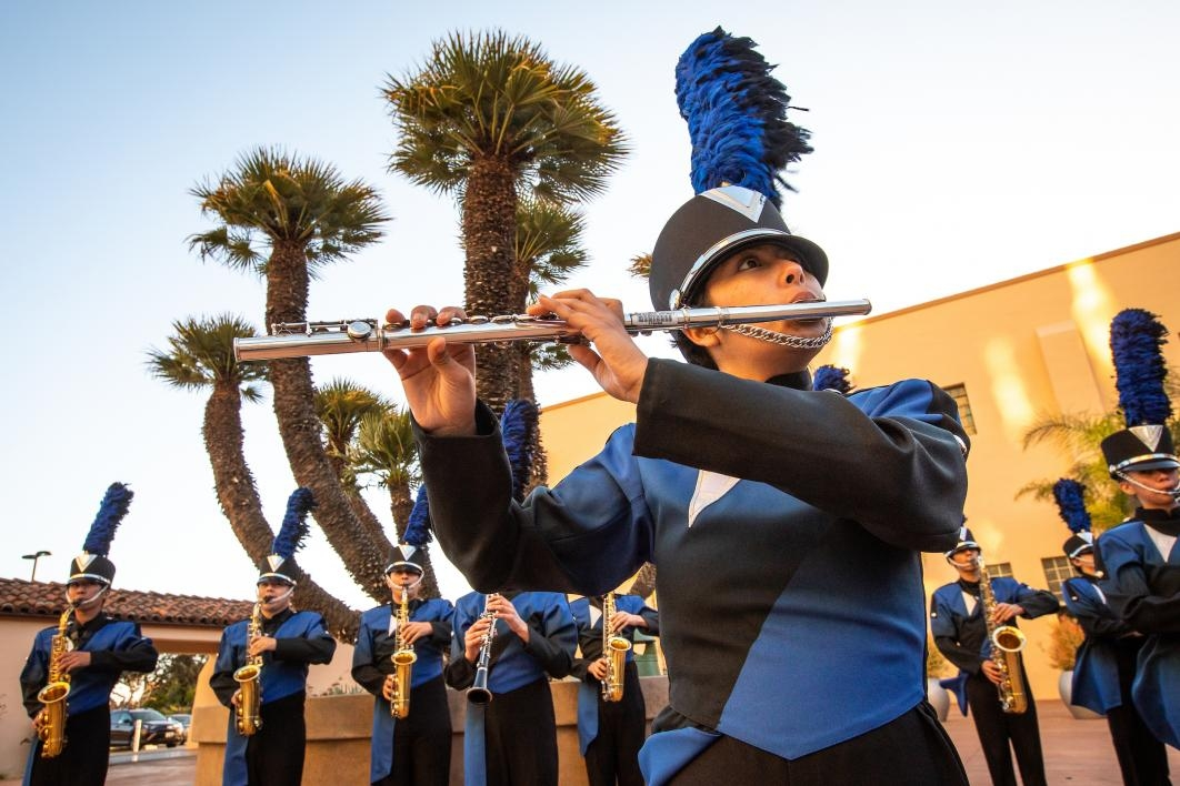 A high school marching band leads a procession at the ASU GSV Summit