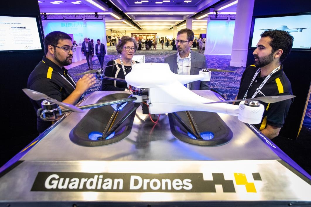 People examine a drone