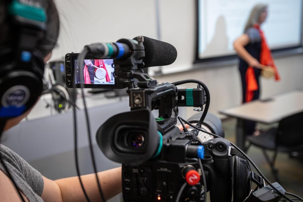 Woman operating a camera