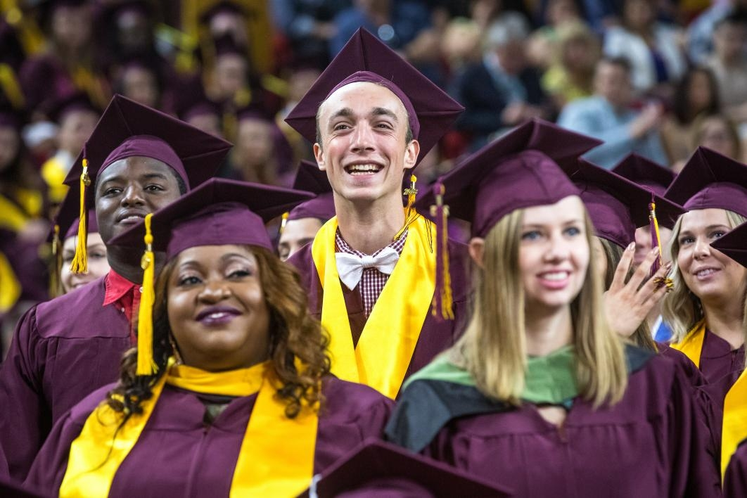 students smiling at graduation