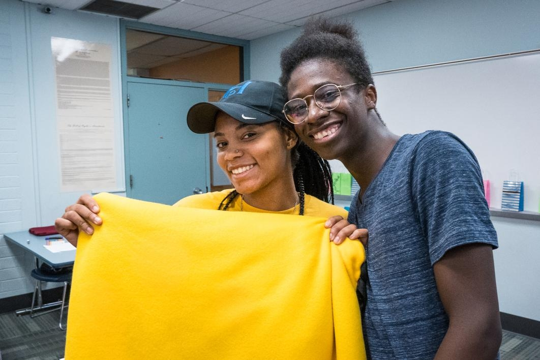 ASU Bridging Success Early Start students show off the blanket they made for Helen's Hope Chest