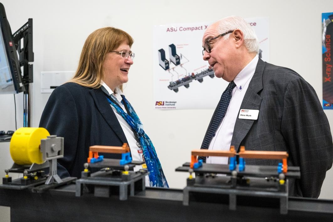 Petra Fromme (left) and Stephen Munk stand in front of a model of the x-ray laser
