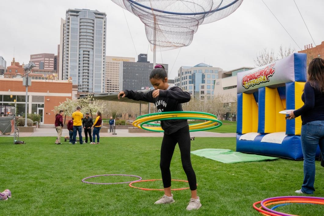 girl hula hoops in civic space park