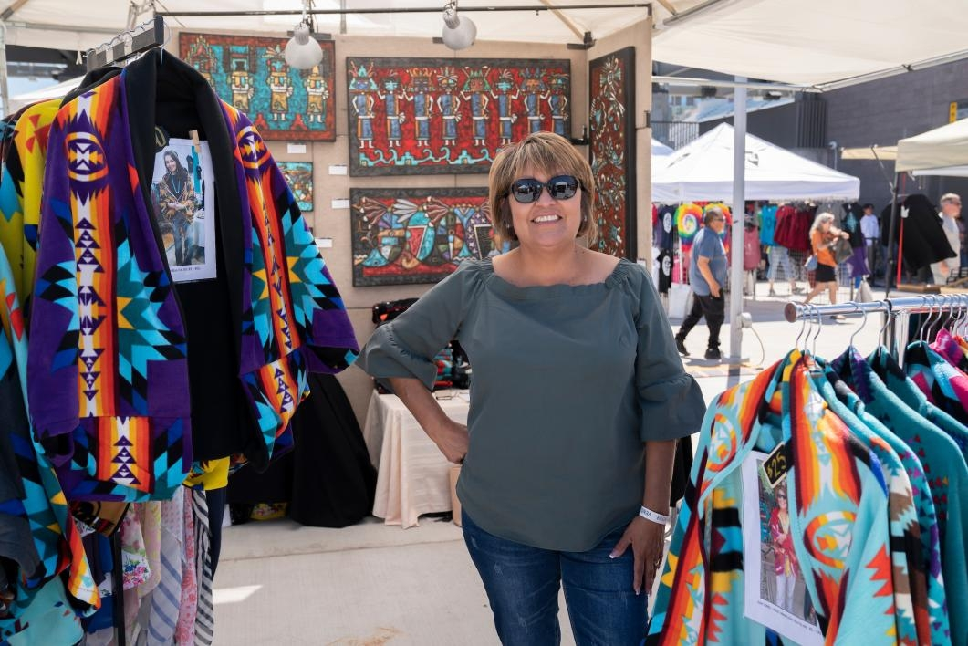 A vendor stands in her booth at the ASU Pow Wow