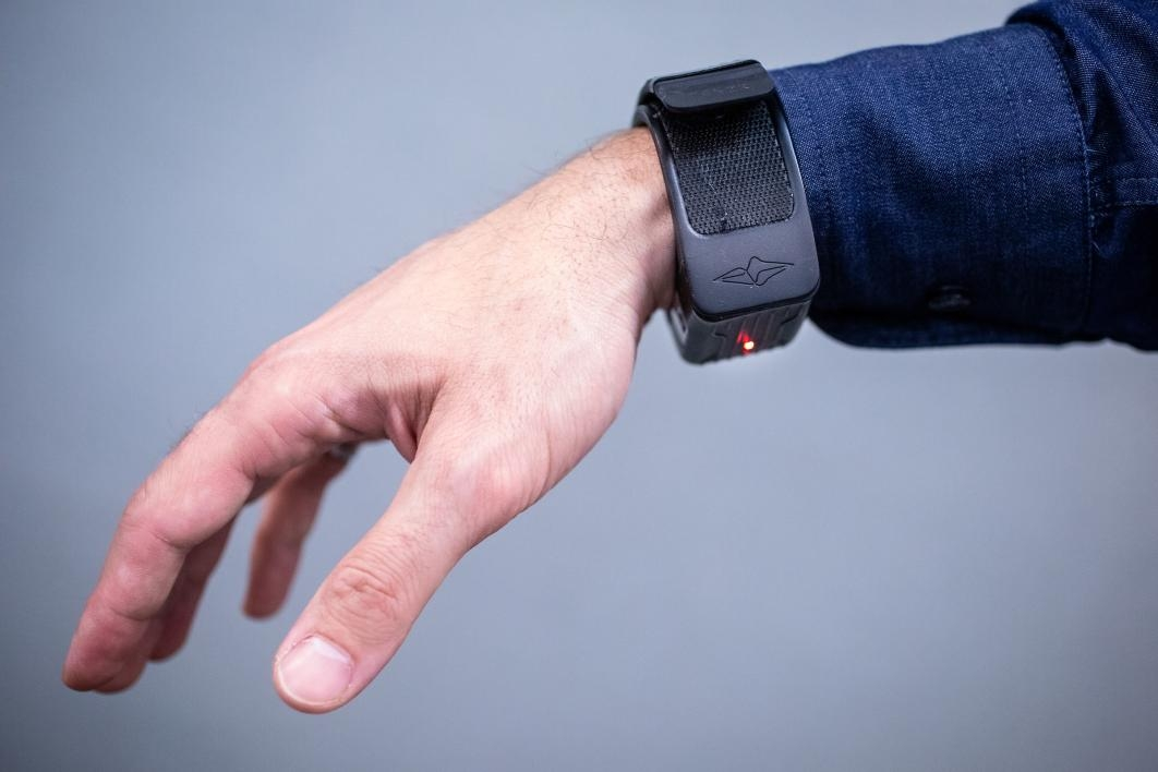 A hand displays a fitness monitor