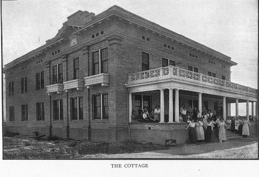 The Cottage dorm is shown in a vintage photo