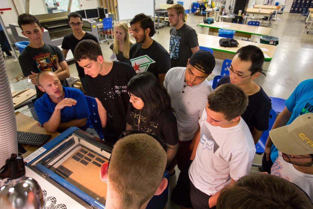 students using a mini laser cutter
