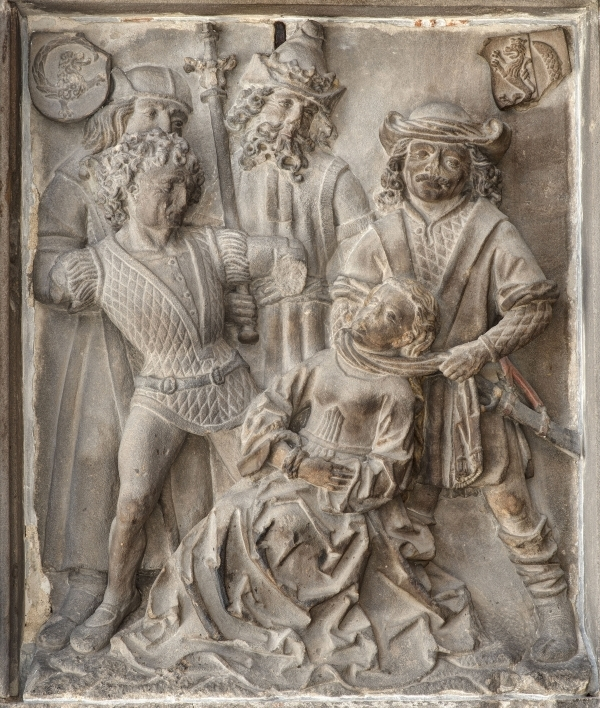 stone relief scuplture depciting the torture of a saint