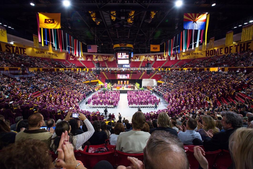 attendees of commencement in Wells Fargo Arena