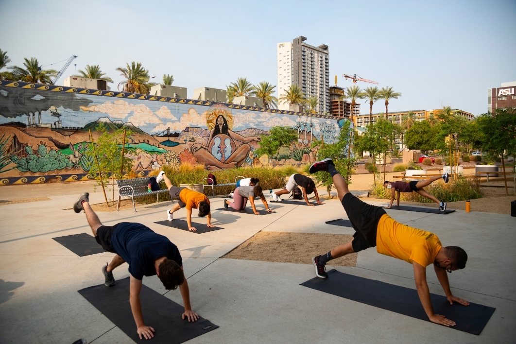 Students do yoga outside on the Downtown Phoenix campus