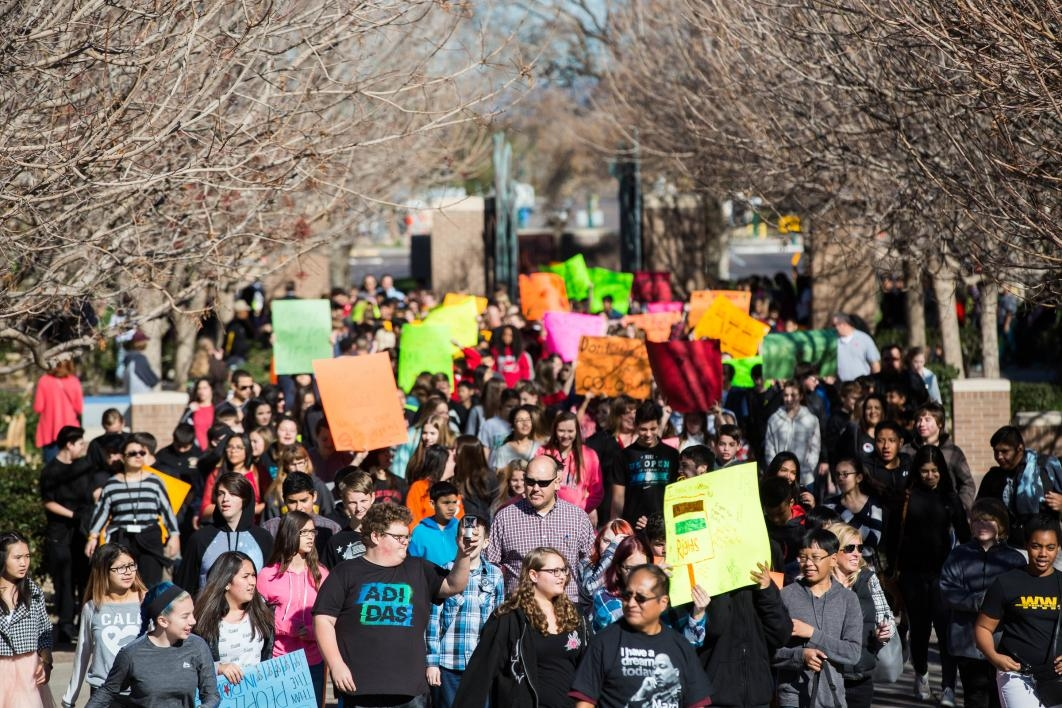Students marching on ASU's West campus