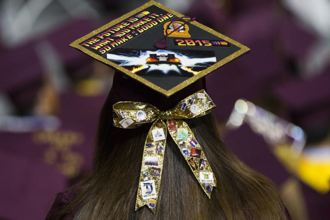 A graduation cap is covered with Back to the future references and a hair bow with the student's personal likes