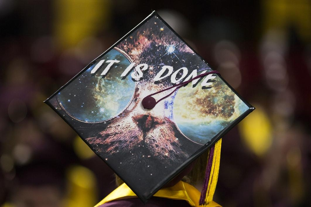"A graduation cap reads, ""It is done,"" and shows a space themed cat."