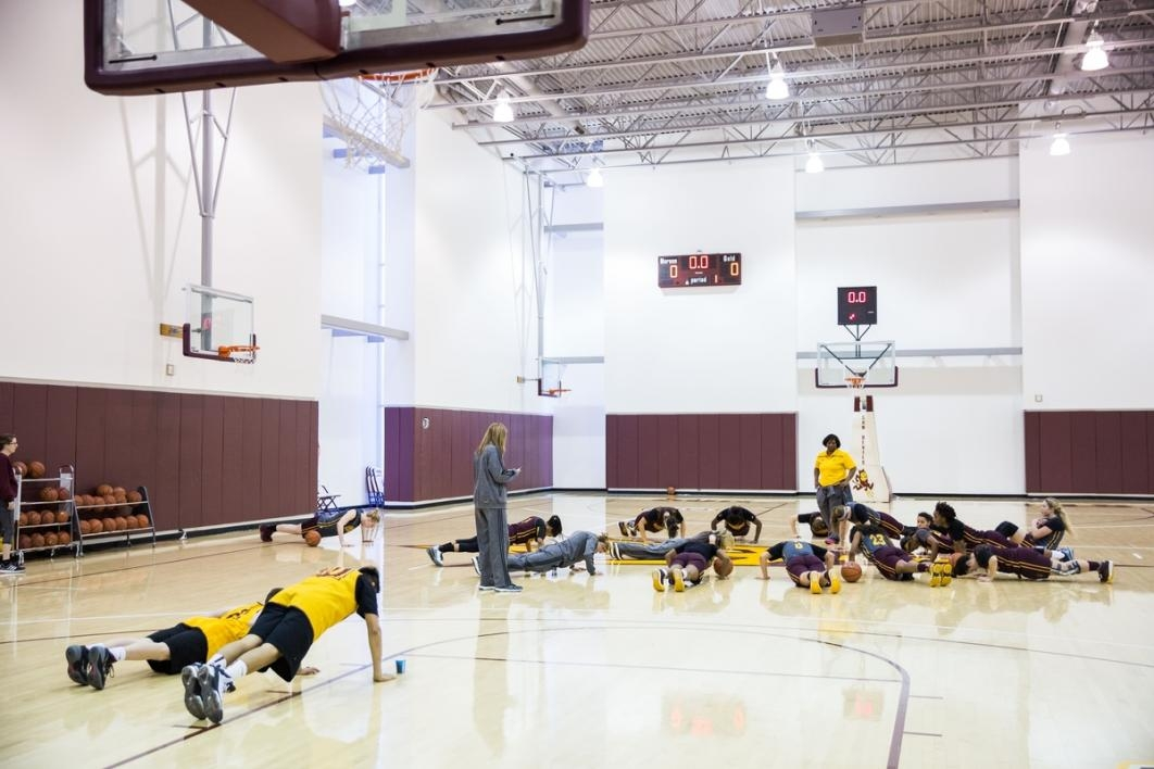 Basketball players doing push-ups.