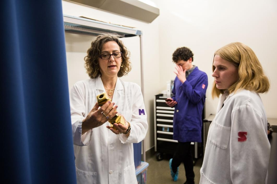 professor in lab with students