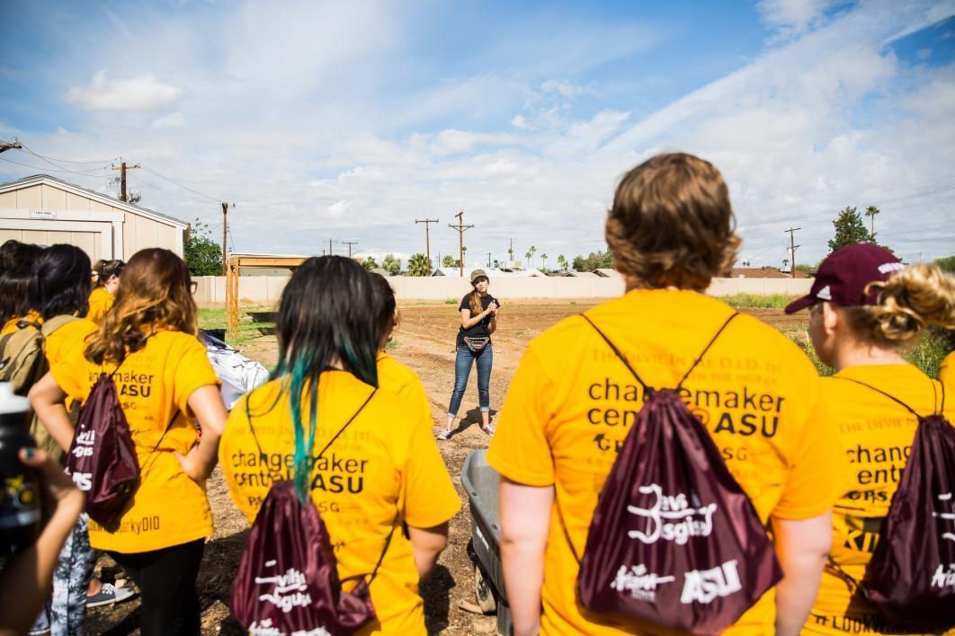 woman talking to group of volunteers