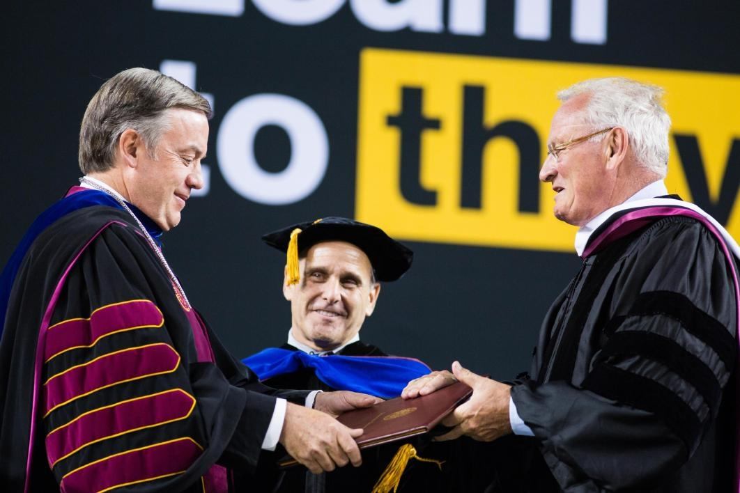 ASU President handing honorary degree to recipient
