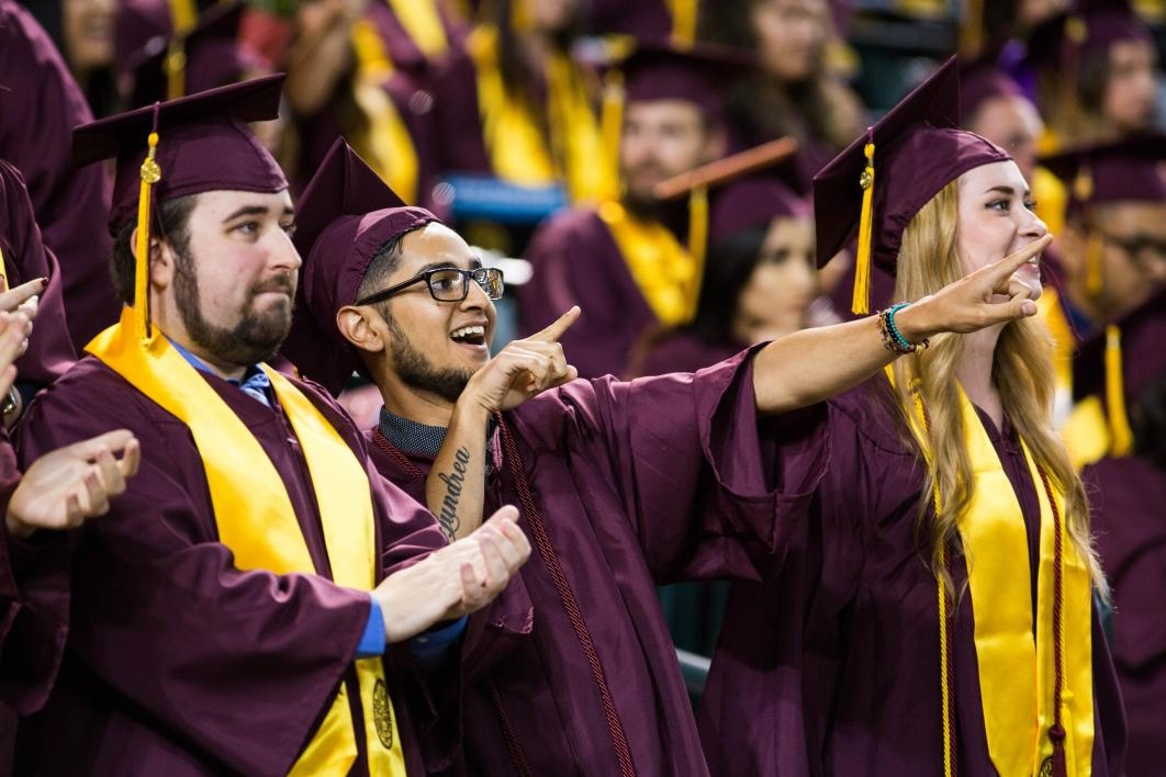 graduates excited at commencement
