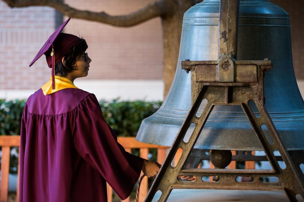 graduate ringing large bell